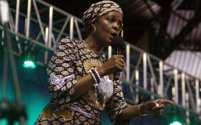 Zimbabwes first lady Grace Mugabe speaks during a campaign meeting at the City Sports Center in Harare, 8 October, 2014. Picture: AFP.