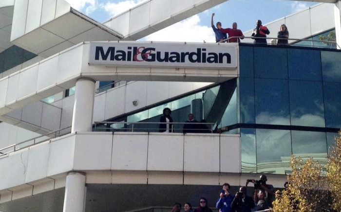 Mail & Guardian staff watch on during an ANC Youth League protest outside the newspapers offices in Rosebank, Johannesburg, 5 June 2014. Picture: Masego Rahlaga/EWN.