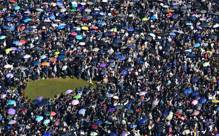 "People gather at Victoria Park for a pro-democracy rally in Hong Kong on 8 December 2019. Hong Kong democracy protesters are hoping for huge crowds December 8 at a rally they have billed as a ""last chance"" for the city's pro-Beijing leaders in a major test for the six-month-old movement. Picture: AFP"