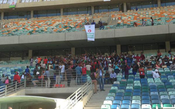 """A small part of the crowd is chanting """"Let them go, we're here to work"""" during an imbizo at the Moses Mabhida Stadium in Durban. Picture: Govan Whittles/EWN"""