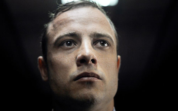 FILE: Oscar Pistorius appears in the Pretoria Magistrates Court, 4 June 2013. Picture: AFP.