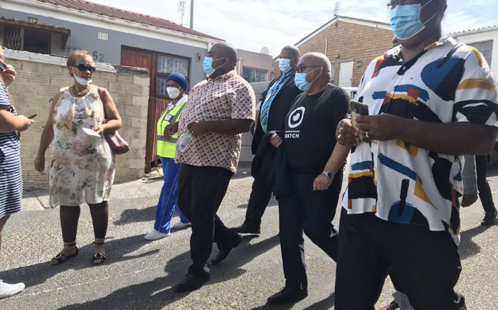 Western Cape Community Safety MEC Albert Fritz (in black) on 1 March 2021 visits the families of the victims of gang-related shootings in Mitchells Plain. Picture: Lizell Persens/Eyewitness News