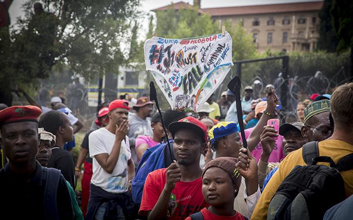 """Protesters hold up a banner at the """"Day of Action"""" march against the leadership of President Jacob Zuma held in Pretoria on 12 April 2017. Picture: Reinart Toerien/EWN"""