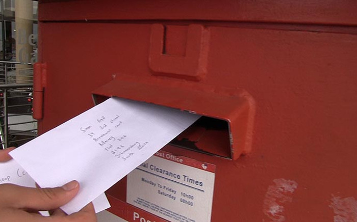 FILE: A letter being posted at the Benmore Gardens post office on 27 November 2014. Picture: Reinart Toerien/EWN