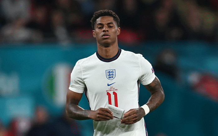 England's forward Marcus Rashford carries a note during the UEFA EURO 2020 final football match between Italy and England at the Wembley Stadium in London on July 11, 2021. Picture: Paul Ellis / POOL / AFP
