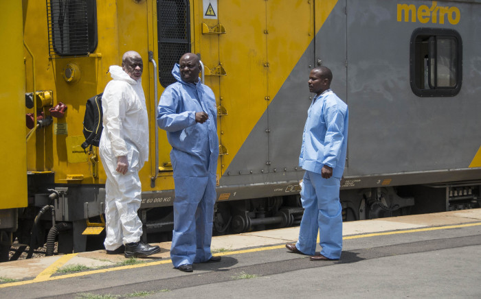Officials and rescue services personnel on the scene of a train collision in Germiston on 9 January 2018. Picture: Ihsaan Haffejee/EWN.