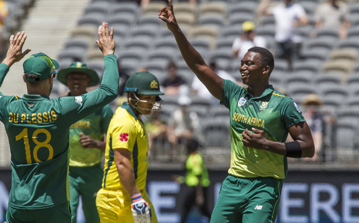 FILE: South Africa's Lungi Ngidi (R) celebrates after taking the wicket of Australia's Aaron Finch (C) during the first one-day international (ODI) cricket match between South Africa and Australia at the Optus Perth stadium in Perth on 4 November 2018. Picture: AFP