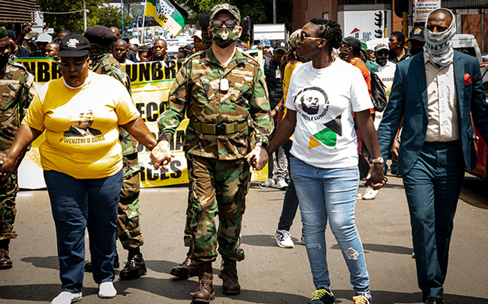 Supporters of former President Jacob Zuma gathered for a protest on 9 October 2020 at the Mary Fitzgerald Square in Newtown, led by Carl Niehaus (centre), spokesperson of the uMkhonto we Sizwe Military Veterans Association. They marched to the Constitutional Court, demanding Deputy Chief Justice Raymond Zondo step down from the commission of inquiry into state capture, accusing him of bias against Zuma. Picture: Xanderleigh Dookey/EWN.