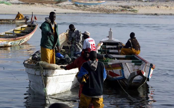 Fishermen prepare to leave the local fishing port of Charca Nouadhibou. Picture: AFP/Seyllou Diallo.