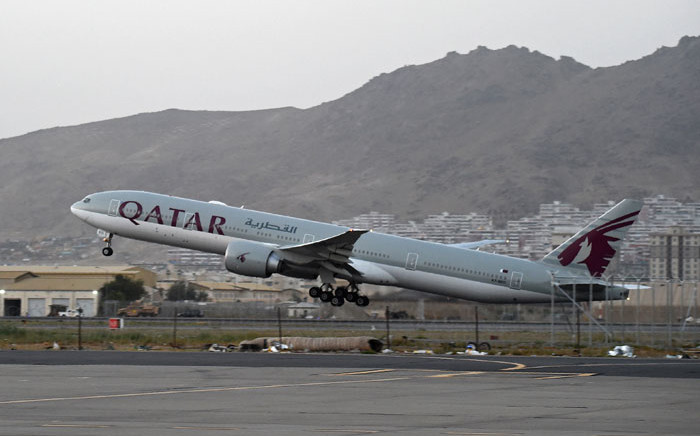 A Qatar Airways aircraft takes off from the airport in Kabul on 9 September 2021. Some 200 passengers, including US citizens, left Kabul airport on on the first flight carrying foreigners out of the Afghan capital since a US-led evacuation ended on 30 August. Picture: Wakil Kohsar/AFP