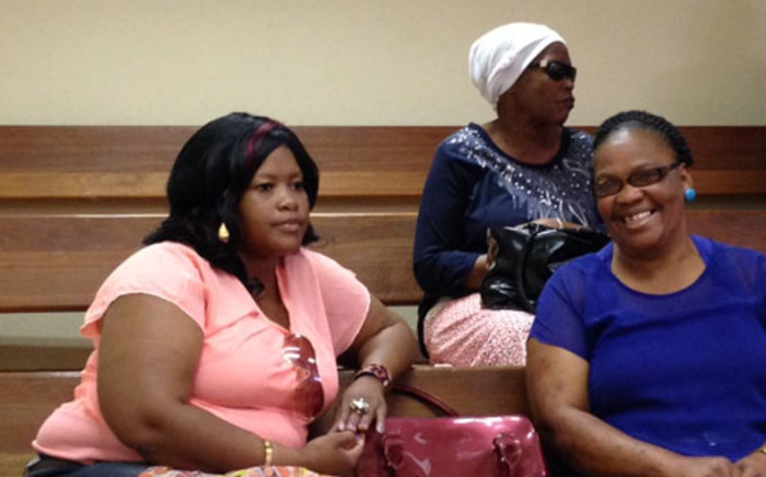 Andries Tatane's widow, Rose (L), as pictured in the Fiksburg Regional Court in the Free State on 18 March 2013. Picture: Andrea van Wyk/EWN
