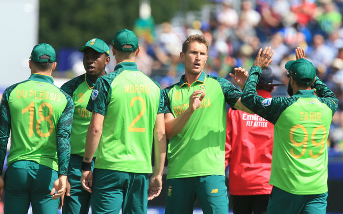 South Africa's Dwaine Pretorius (2R) celebrates with teammates after bowling Sri Lanka's Kusal Perera for 30 during the 2019 Cricket World Cup group stage match between Sri Lanka and South Africa at the Riverside Ground, in Chester-le-Street, northeast England, on 28 June 2019. Picture: AFP