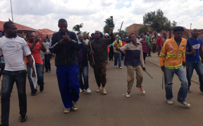 FILE: Angry residents in Bekkersdal protest against poor service delivery on 23 October 2013. Picture: Sebabatso Mosamo/EWN.