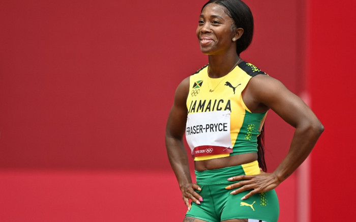 Jamaica's Shelly-Ann Fraser-Pryce reacts prior to competing in the women's 100m heats during the Tokyo 2020 Olympic Games at the Olympic Stadium in Tokyo on 30 July 2021. Picture: AFP