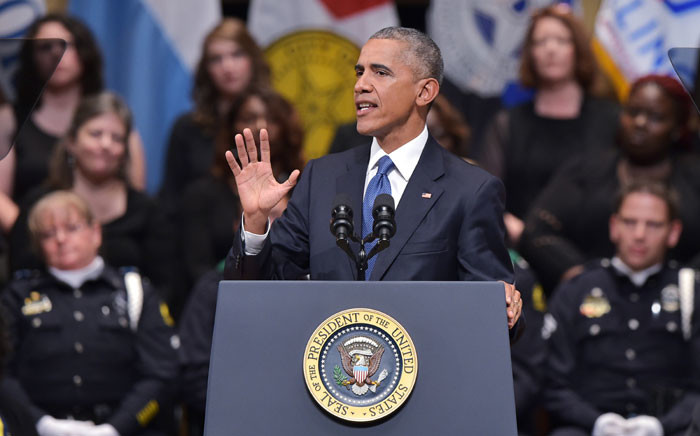 US President Barack Obama speaks during an interfaith memorial service for the victims of the Dallas police shooting at the Morton H. Meyerson Symphony Center on July 12, 2016 in Dallas, Texas. President Barack Obama attended a somber memorial Tuesday to five police officers slain in a sniper ambush in Dallas, as he seeks to unify a country divided by race and politics. Picture: AFP