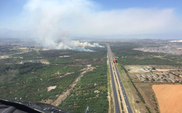 Earlier the blaze forced the closure of a section of the N2 due to poor visibility caused by the smoke. Picture: Working on Fire @wo_fire.