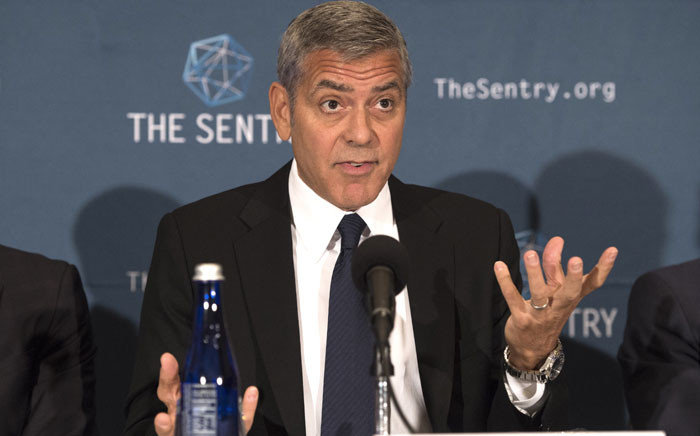 Actor George Clooney, human rights activist and co-founder of Sentry, speaks during a news conference on 12 September 2016 in Washington, DC. Picture: AFP.