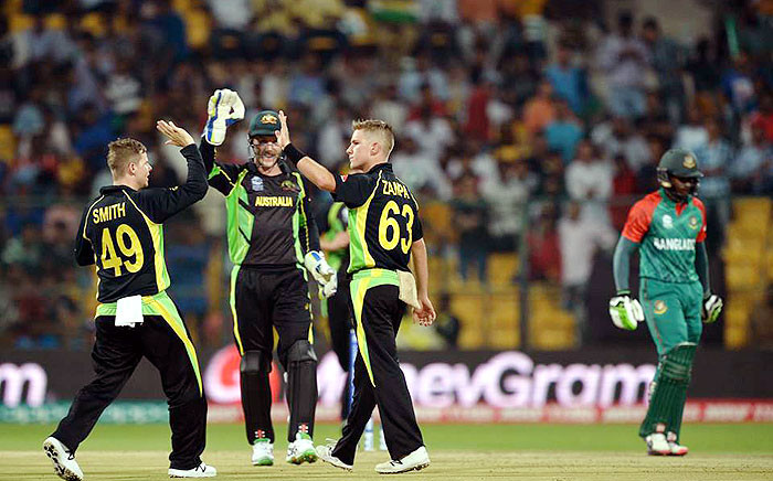 Australian players celebrate the fall of a Bangladeshi wicket during their ICC World T20 World Cup match in Bengaluru, India on 21 March 2016. Picture: ICC/Facebook.