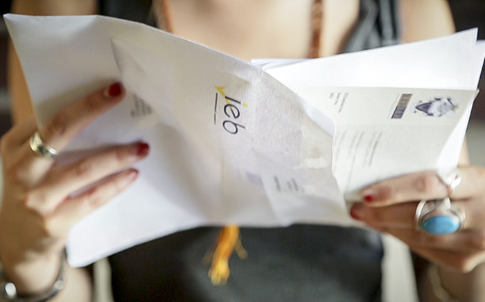 FILE: A matric pupil from checks the results from her IEB Matric exams. Picture: Thomas Holder/EWN