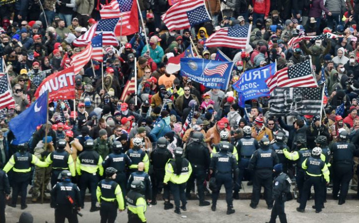 FILE: Trump supporters clash with police and security forces as they storm the US Capitol in Washington, DC on 6 January 2021. Donald Trump's supporters stormed a session of Congress held to certify Joe Biden's election win. Picture: AFP