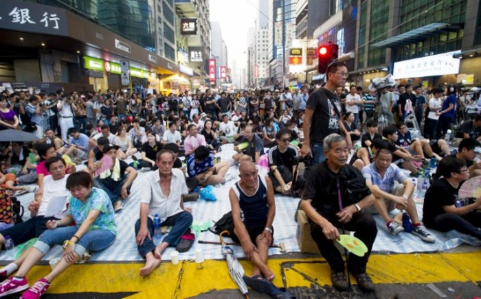 FILE: Pro-democracy protesters gather in the Mong Kok district of Hong Kong on 30 September,2014. Picture: AFP.