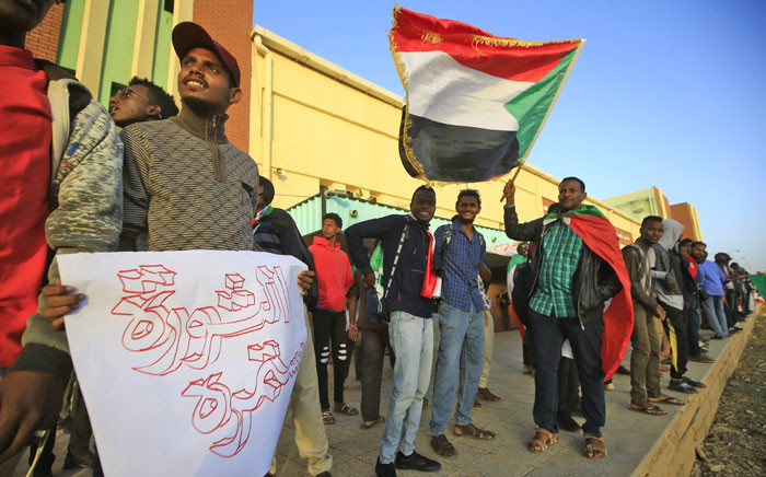 Sudanese protesters wait at a train station in Khartoum to board a train to Atbara on 19 December 2019 to celebrate the one-year anniversary of their protest movement that brought down Omar al-Bashir last April after a thirty-year rule. Picture: AFP