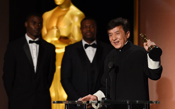 Actor Jackie Chan accepts his award on stage during the 8th Annual Governors Awards hosted by the Academy of Motion Picture Arts and Sciences at the Hollywood & Highland Center in Hollywood, California on 12 November 2016. Picture: AFP