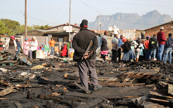 Raging shack fire in Langa destroys residents' possessions and leaves 45 people homeless. Picture: Anthony Molyneaux/EWN