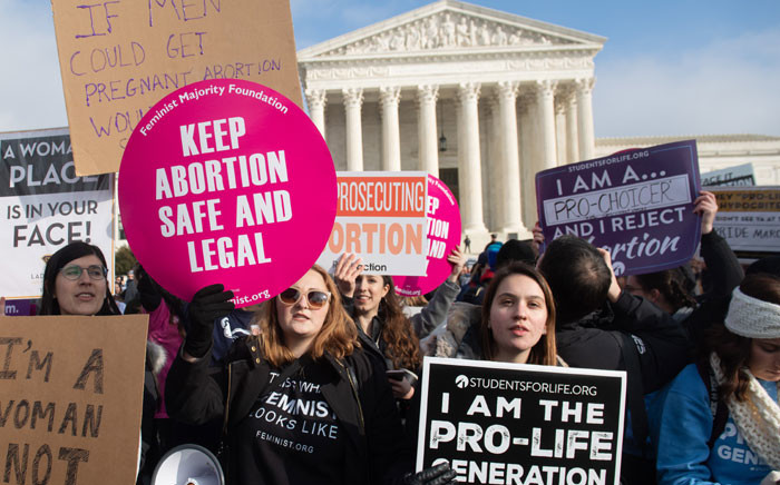 "In this file photo taken on 18 January 2019, pro-choice activists hold signs alongside anti-abortion activists participating in the ""March for Life,"" an annual event to mark the anniversary of the 1973 Supreme Court case Roe v Wade, which legalized abortion in the US, outside the US Supreme Court in Washington, DC. Picture: AFP"