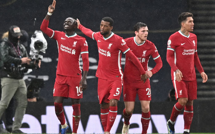 Liverpool striker Sadio Mane (L) celebrates scoring their third goal during the English Premier League football match between Tottenham Hotspur and Liverpool at Tottenham Hotspur Stadium in London, on 28 January 2021. Picture: Shaun Botterill/AFP