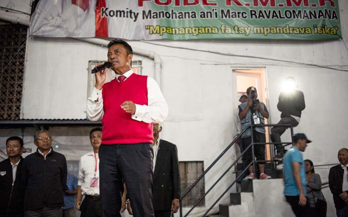 Marc Ravalomanana (L), former Madagascan president and presidential candidate, speaks to supporters at his headquarters in Antananarivo on 7 November 2018, after the first round of Madagascar's presidential election. Picture: AFP.