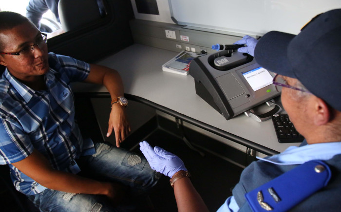 A driver sits in the new mobile, random breath testing station as he waits for the officer to perform the test. Western Cape Traffic launched a mobile, random breath testing station, the first of its kind in the country. Picture: Bertram Malgas/EWN.