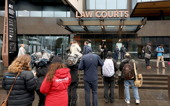 Journalists gather outside the Christchurch District Court on 5 April 2019 as alleged gunman Brenton Tarrant, accused of shooting dead 50 Muslims during the 15 March attack on two mosques, appeared for his hearing via audio-visual link from a maximum-security prison in Auckland. Picture: AFP