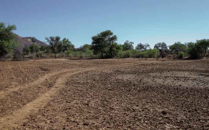FILE: A general view of a dried-up farm dam is seen on 25 November 2019 at a cattle farm on the outskirts of Windhoek, Namibia, amid a drought. Picture: AFP.