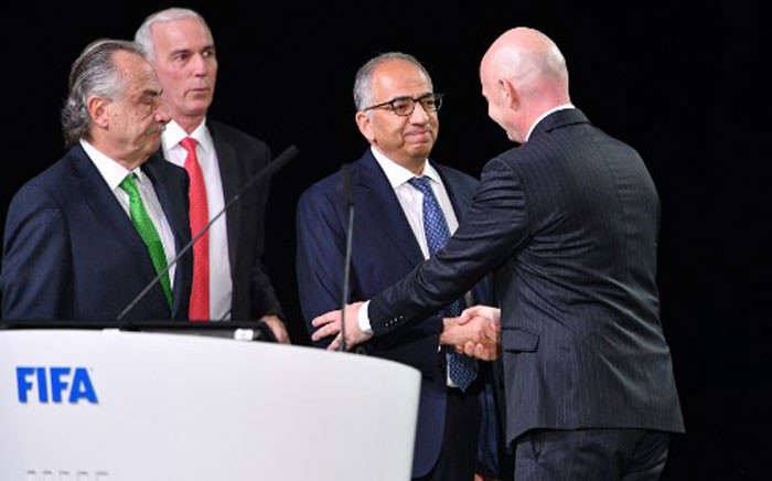 Fifa president Gianni Infantino (R) congratulates the United 2026 bid (Canada-Mexico-US) officials Carlos Cordeiro (C), president of the United States Football Association, president of the Mexican Football Association Decio de Maria Serrano (L) and Steve Reed (2nd L), president of the Canadian Soccer Association, following the announcement of the 2026 World Cup host during the 68th Fifa Congress at the Expocentre in Moscow on 13 June 13 2018. Picture: AFP