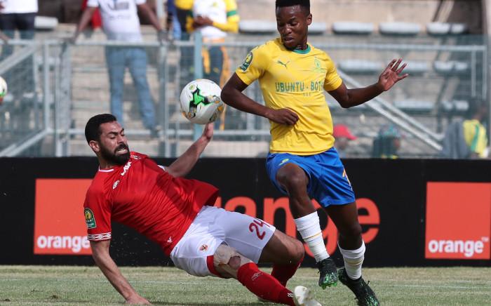 Themba Zwane evades an Al Ahly defender at the Lucas 'Masterpieces' Moripe stadium on 6 April 2019. Picture: sundownsfc.com
