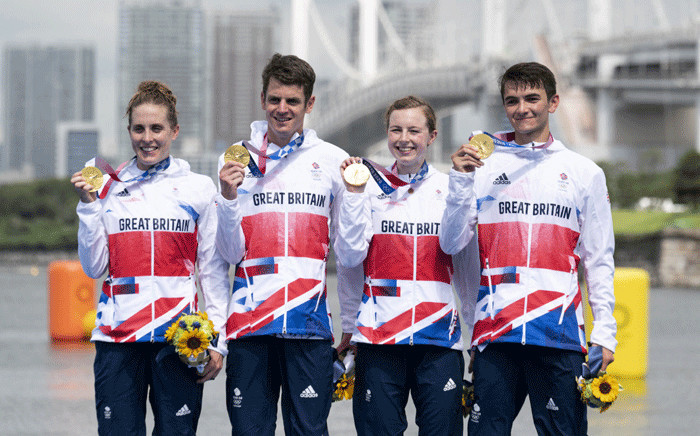 Great Britain's Alex Yee, Georgia Taylor-Brown Jessica Learmonth and Jonathan Brownlee pose on the podium during the medal ceremony after competing in the mixed relay Triathlon competition at the Odaiba Marine Park, in Tokyo, on July 31, 2021 during the Tokyo 2020 Olympic Games. Picture: Charly TRIBALLEAU / AFP