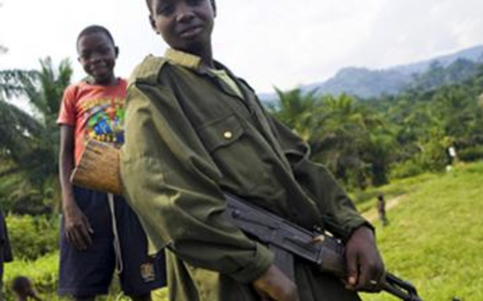 Rwanda children turned into child soldiers. Picture: AFP