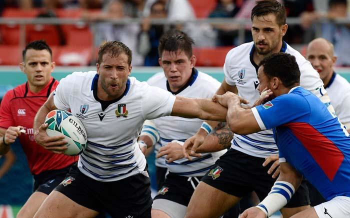 Italy's centre Tommaso Benvenuti (L) fends off a tackle during the Japan 2019 Rugby World Cup Pool B match between Italy and Namibia at the Hanazono Rugby Stadium in Higashiosaka on 22 September 2019. Picture: AFP