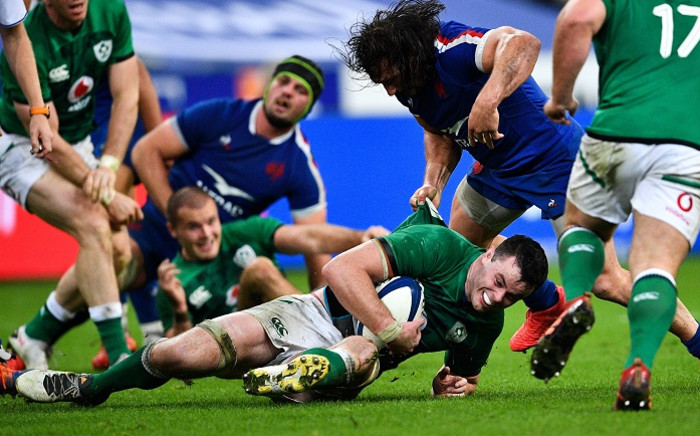 Ireland's lock James Ryan (C) is tackled by France's hooker Camille Chat (R) during the Six Nations rugby union tournament match between France and Ireland at the stade de France, in Saint Denis, on the outskirts of Paris, on 31 October 2020. Picture: AFP.