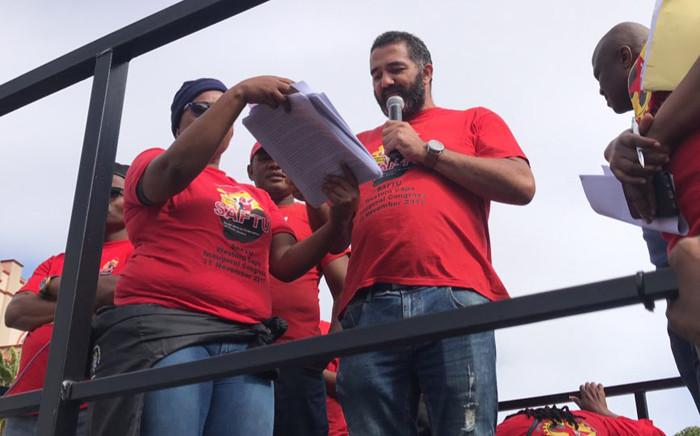 Saftu's Western Cape spokesperson Andre Adams reading their memorandum outside Parliament.  Picture: Kaylynn Palm/EWN.