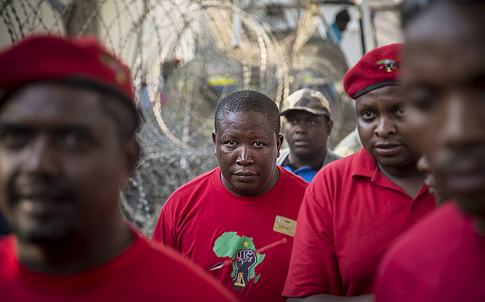FILE. EFF leader Julius Malema makes his way to the stage to address party members at the Constitutional court after judgement was reserved in the Nkandla matter on 09 February 2016. Picture: Reinart Toerien/EWN.