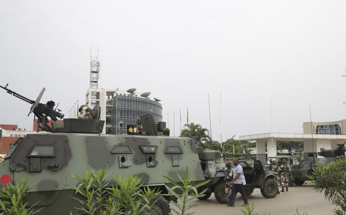 Gabonese soldiers stand in front of the headquarters of the national broadcaster Radiodiffusion Television Gabonaise (RTG) in Libreville on 7 January 2019 after a group of soldiers sought to take power in Gabon while the country's ailing president was abroad. Picture: AFP