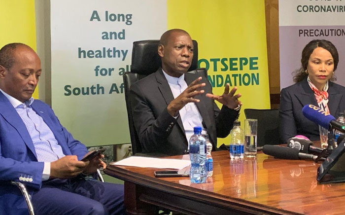 Patrice Motsepe (left) and Precious Moloi-Motsepe of the Motsepe Foundation join Health Minister Zweli Mkhize (centre) during a handover presentation of personal protective equipment for health workers in Sandton on 7 April 2020. Picture: @DrZweliMkhize/Twitter