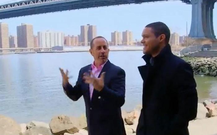 A screengrab of Seinfeld and Noah walking through Brooklyn.