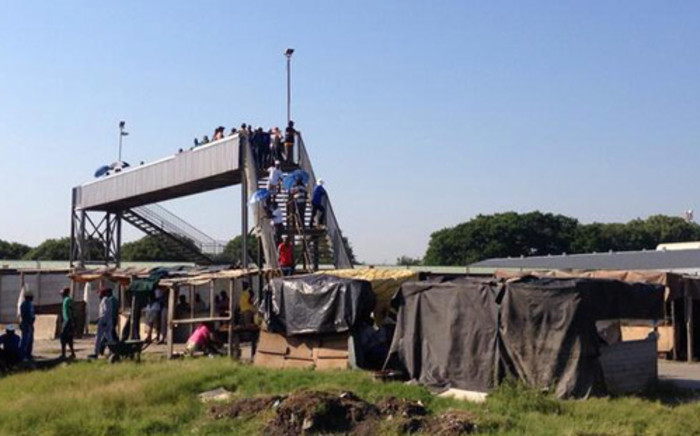 FILE: Miners blocking a bridge at Amplats Thembalani shaft, checking who is reporting for duty. Picture: Govan Whittles/EWN.