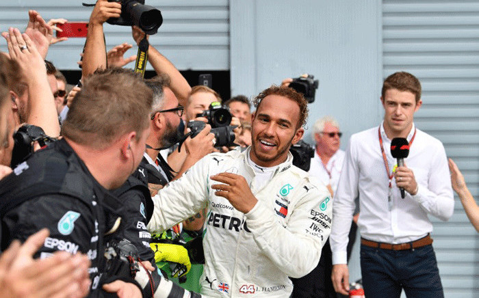 Mercedes' British driver Lewis Hamilton reacts after winning the Italian Formula One Grand Prix at the Autodromo Nazionale circuit in Monza on 2 September, 2018. Picture: AFP.