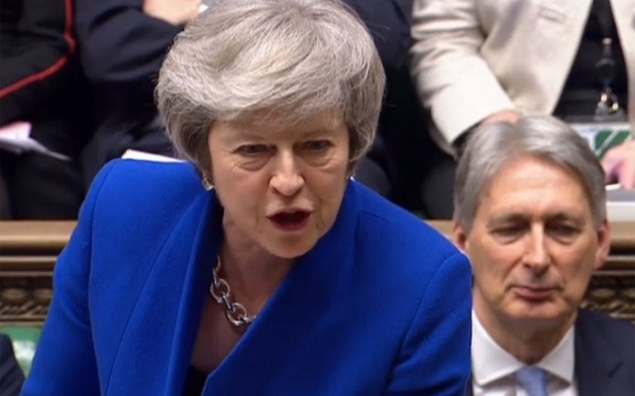 A video grab from footage broadcast by the UK Parliament's Parliamentary Recording Unit shows Britain's Prime Minister Theresa May as she speaks during the weekly Prime Minister's Questions in the House of Commons in London on 16 January 2019, ahead of a debate and vote on a motion of no confidence in the government. Picture: AFP