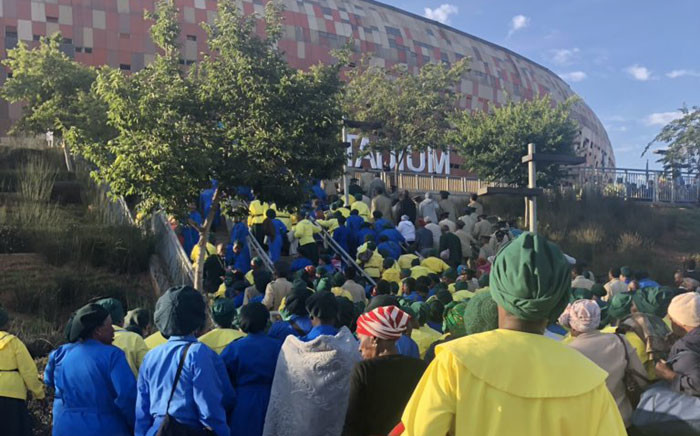 People start making their way into the FNB Stadium for the National Day of Prayer. Picture: Twitter.