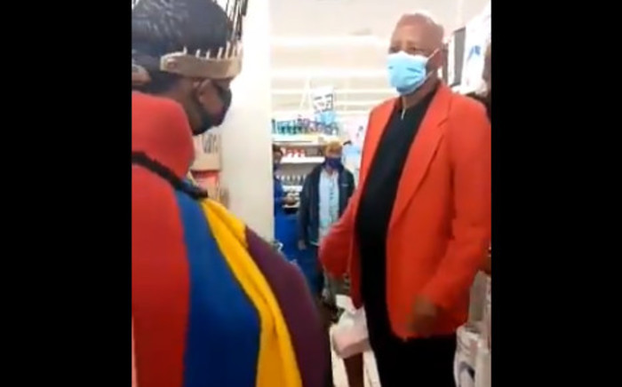 Screenshot of video where activist Thando Mahlangu can be seen in his traditional regalia inside a Clicks store at Boulders Shopping Centre in Midrand – while centre manager Jose Maponyane asks him to leave. Picture: Twitter/Screengrab